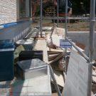 before:建物建築中 玄関前階段からのリビング前犬走り